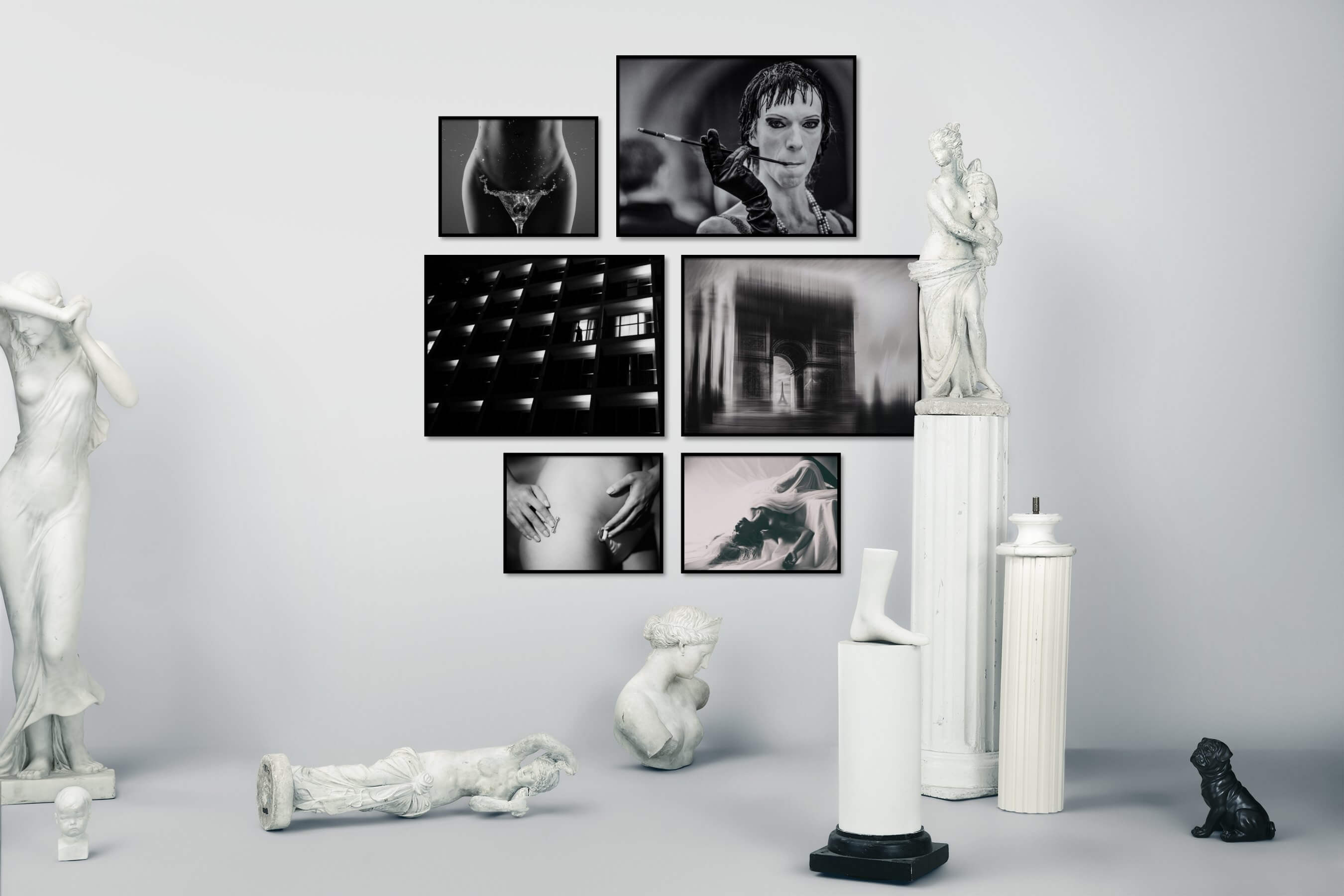 Gallery wall idea with six framed pictures arranged on a wall depicting Fashion & Beauty, Black & White, For the Moderate, and City Life