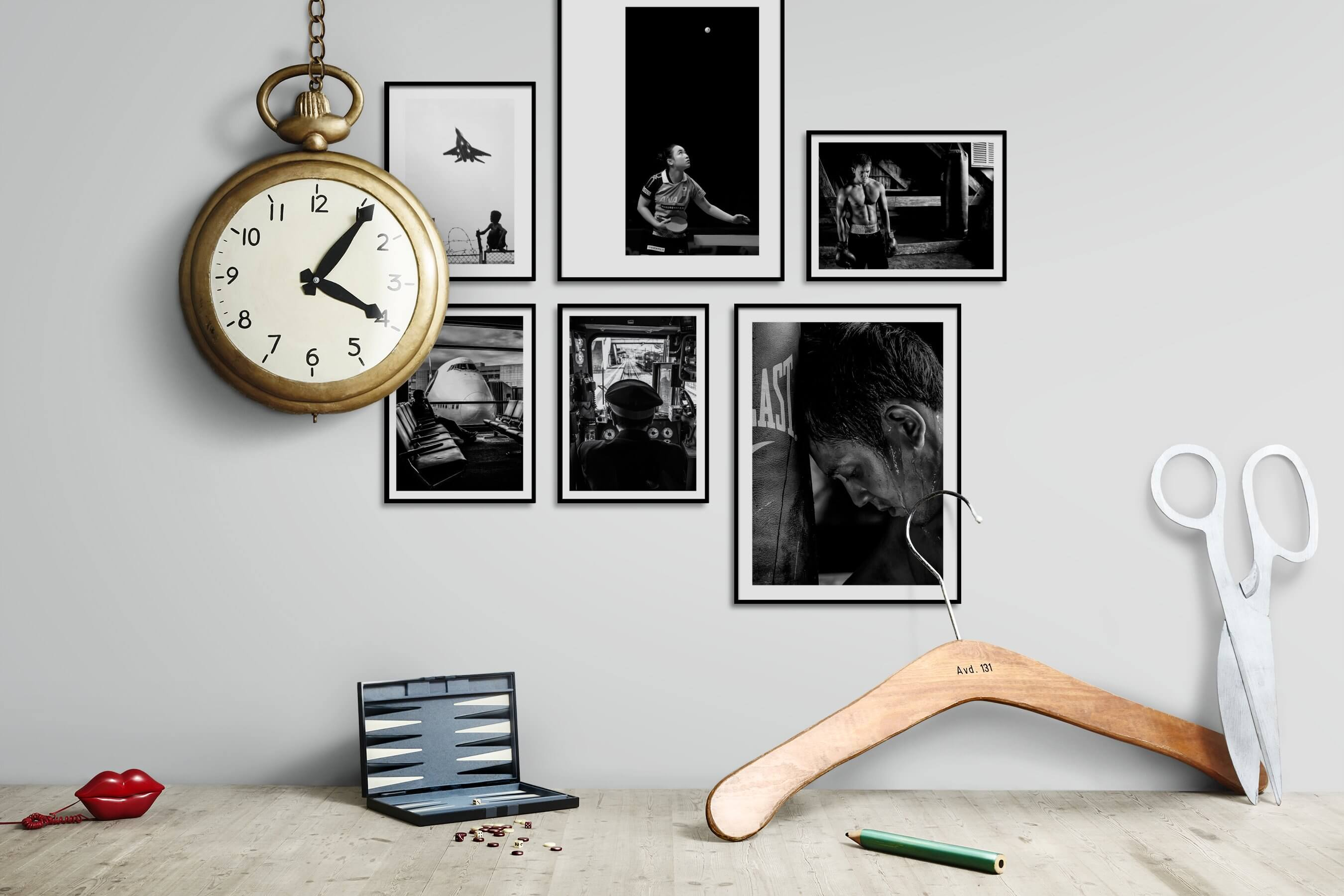 Gallery wall idea with six framed pictures arranged on a wall depicting Black & White, For the Minimalist, City Life, Vintage, and Fashion & Beauty