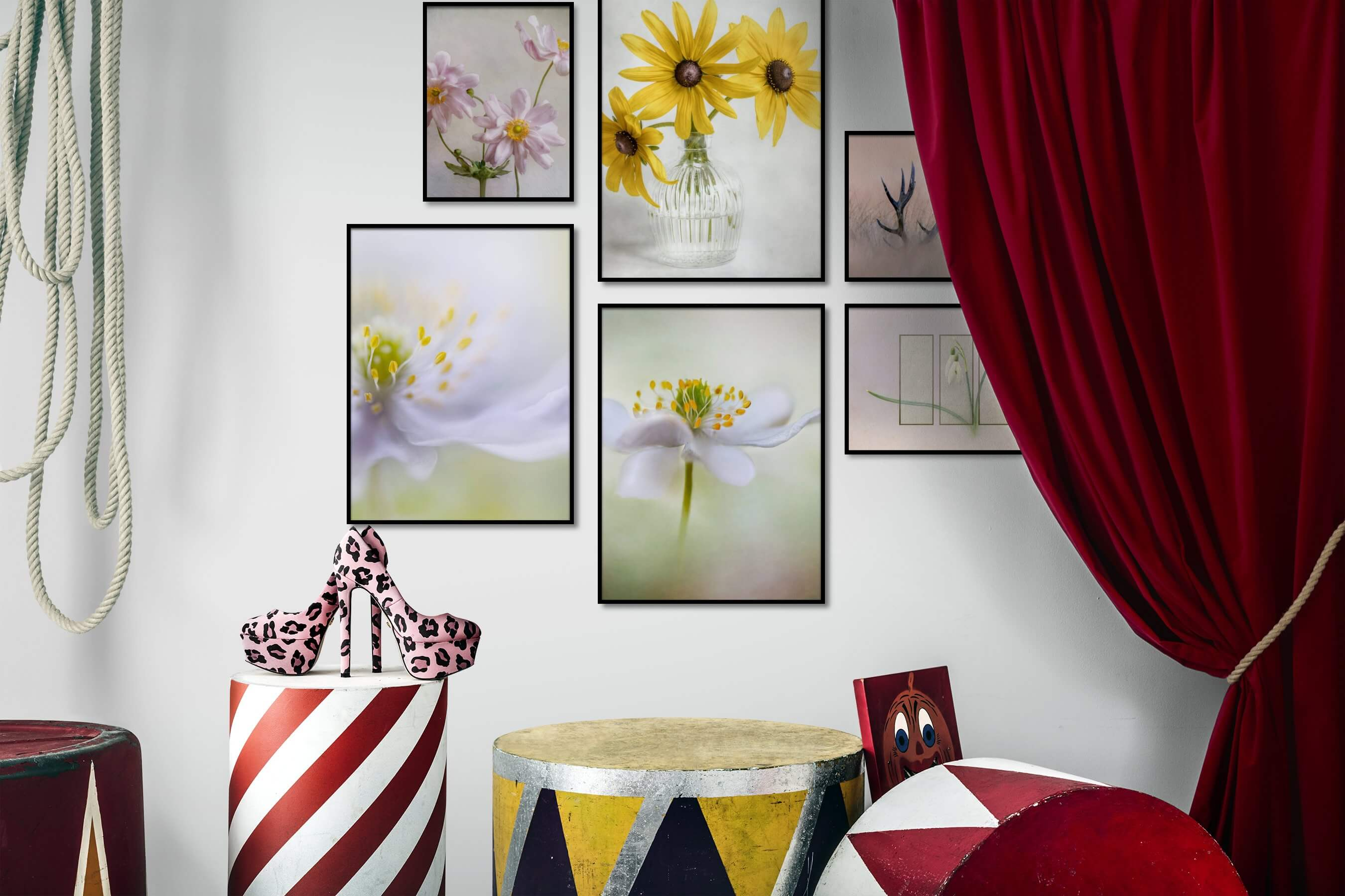 Gallery wall idea with six framed pictures arranged on a wall depicting Flowers & Plants, For the Minimalist, Nature, Animals, and Mindfulness