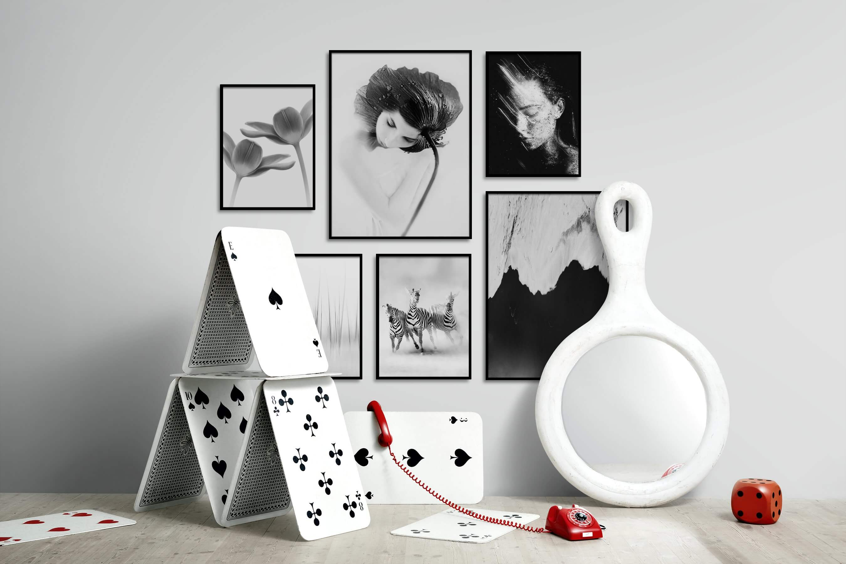Gallery wall idea with six framed pictures arranged on a wall depicting Black & White, For the Minimalist, Flowers & Plants, Vintage, Artsy, For the Moderate, Bright Tones, Mindfulness, Animals, Fashion & Beauty, Dark Tones, and Beach & Water