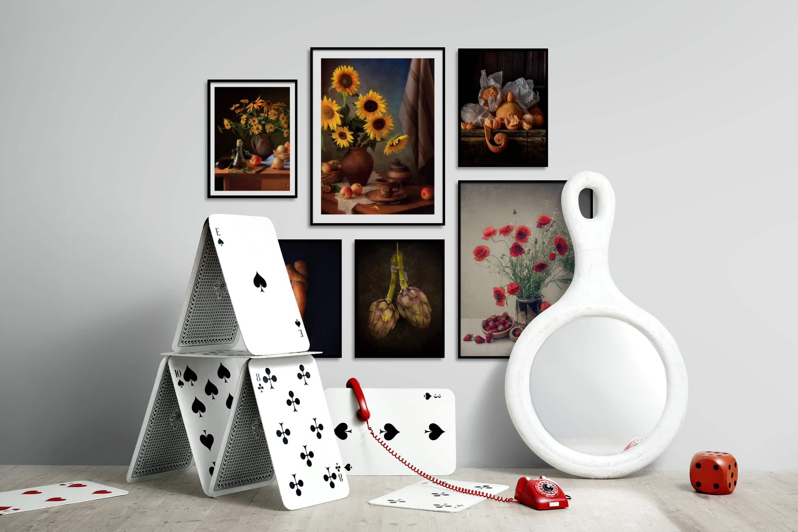 Gallery wall idea with six framed pictures arranged on a wall depicting Flowers & Plants, Vintage, Dark Tones, For the Minimalist, and For the Moderate