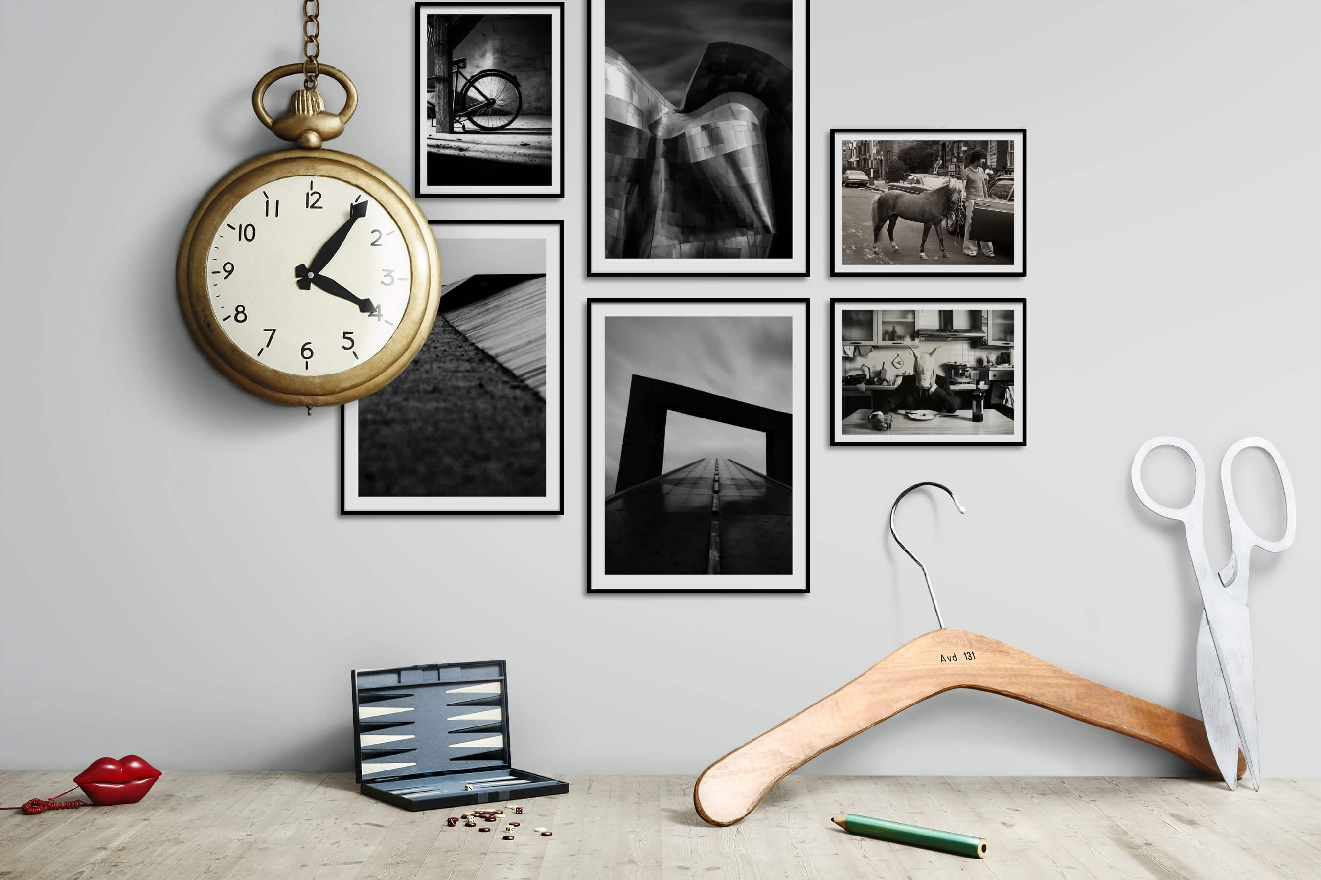 Gallery wall idea with six framed pictures arranged on a wall depicting Black & White, For the Moderate, For the Minimalist, Animals, City Life, Americana, Vintage, and Artsy
