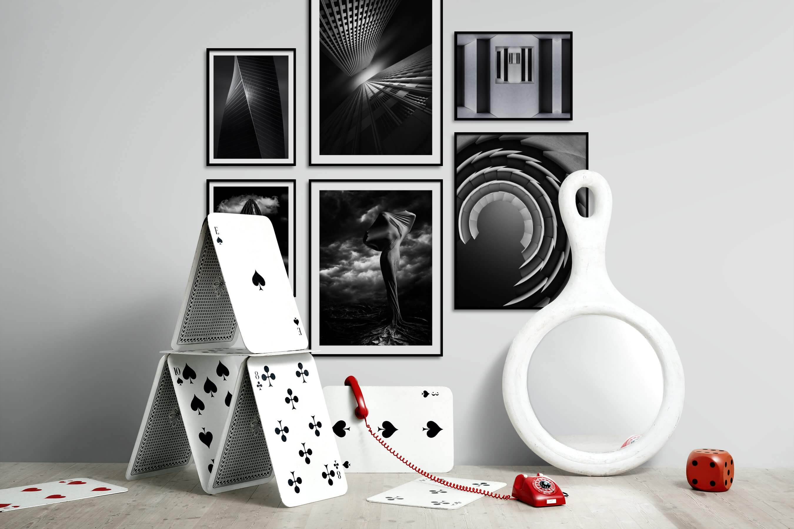 Gallery wall idea with six framed pictures arranged on a wall depicting Black & White, For the Minimalist, City Life, For the Moderate, and Artsy