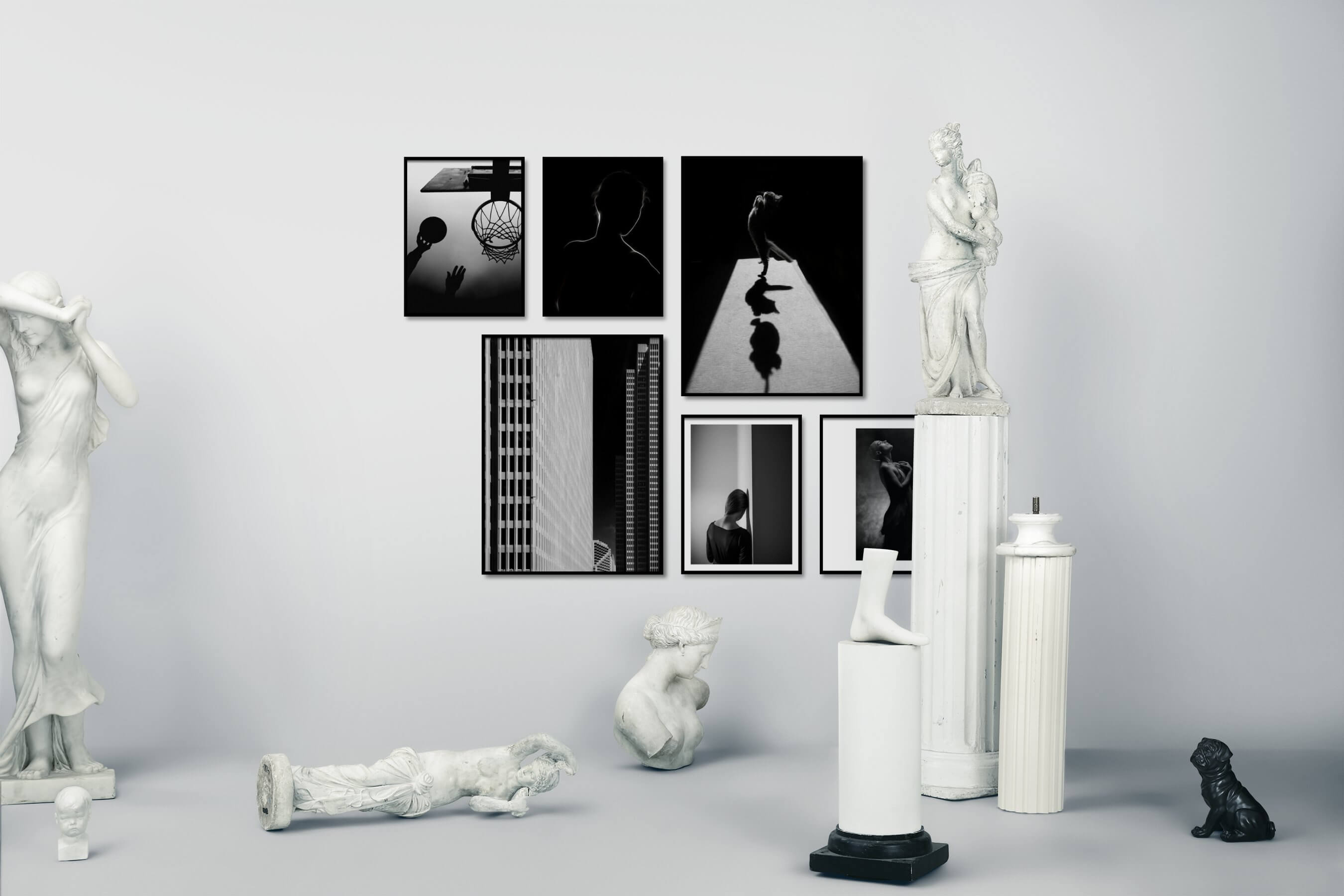 Gallery wall idea with six framed pictures arranged on a wall depicting Black & White, For the Moderate, Fashion & Beauty, Dark Tones, For the Minimalist, City Life, Americana, and Animals