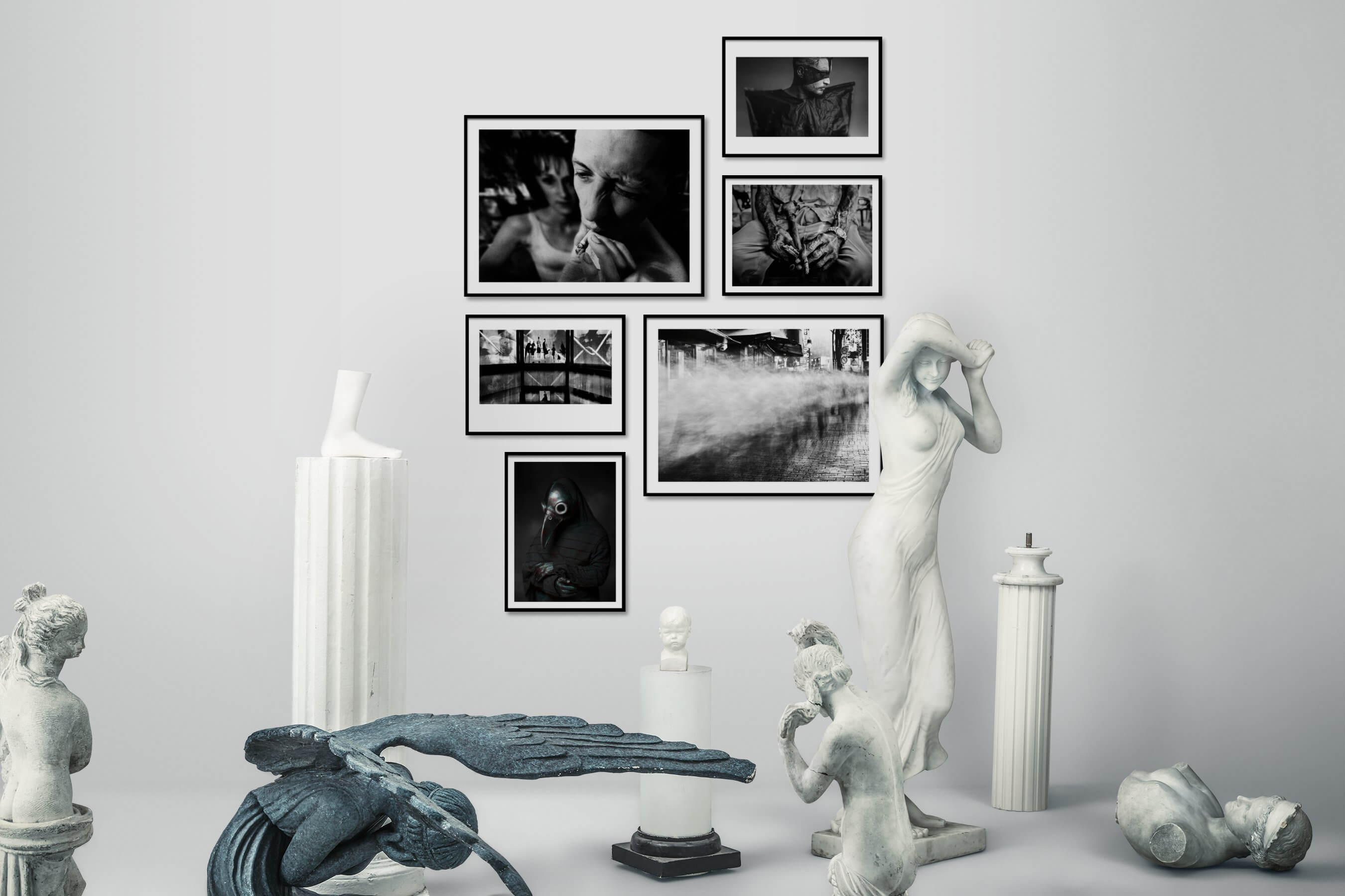 Gallery wall idea with six framed pictures arranged on a wall depicting Artsy, Black & White, For the Moderate, and City Life