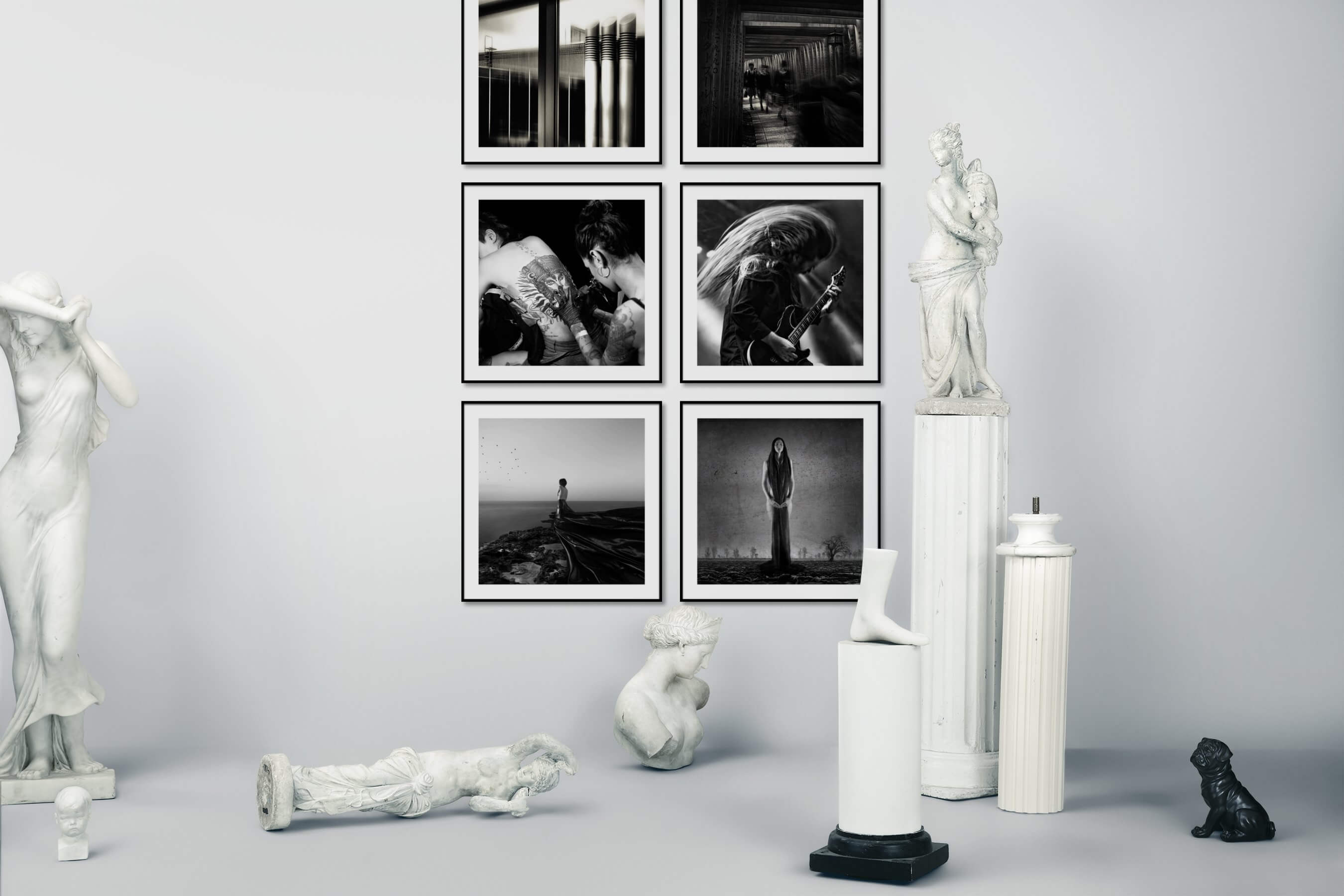 Gallery wall idea with six framed pictures arranged on a wall depicting Black & White, For the Moderate, City Life, Fashion & Beauty, Beach & Water, and Artsy