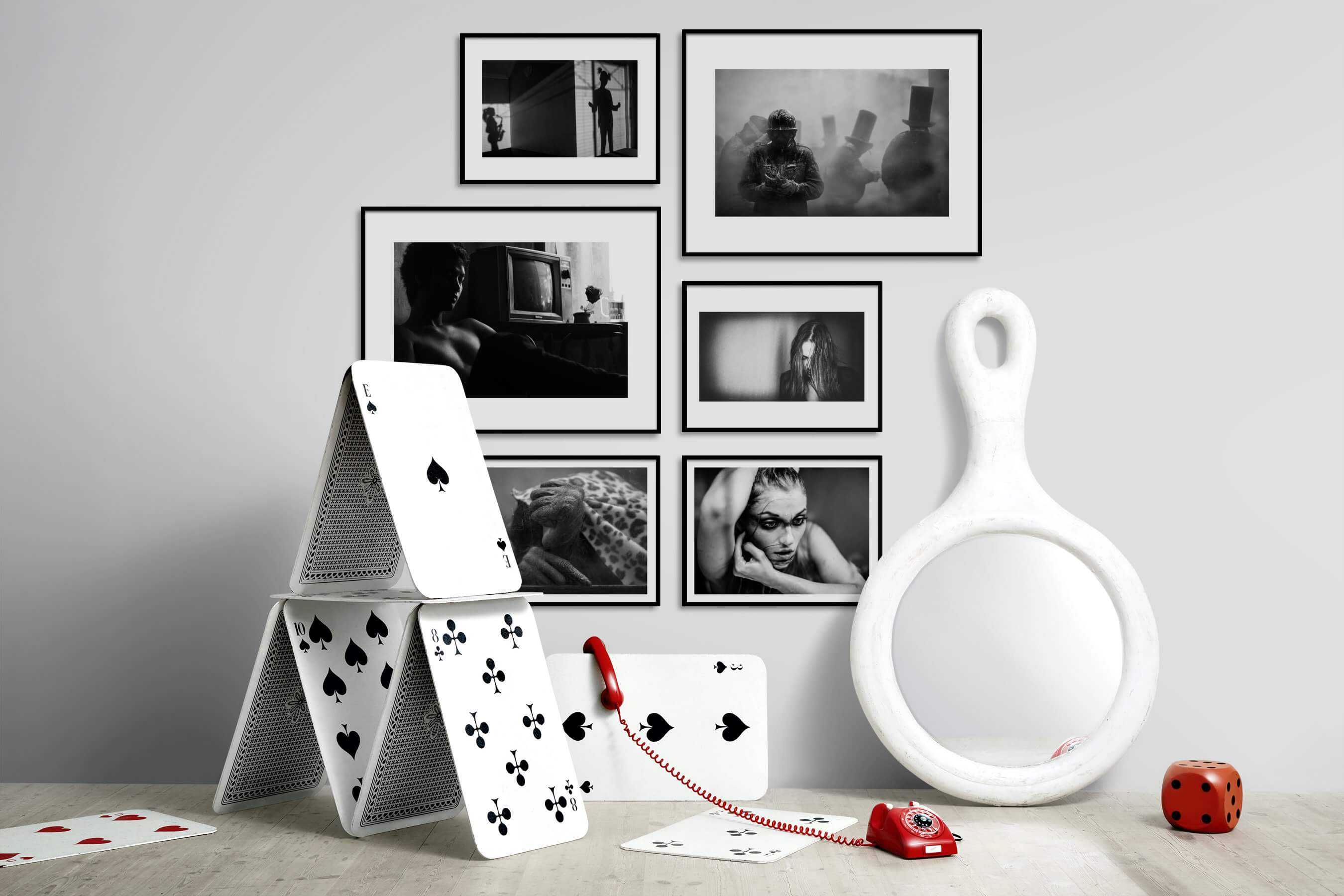 Gallery wall idea with six framed pictures arranged on a wall depicting Artsy, Black & White, Vintage, Fashion & Beauty, and For the Minimalist