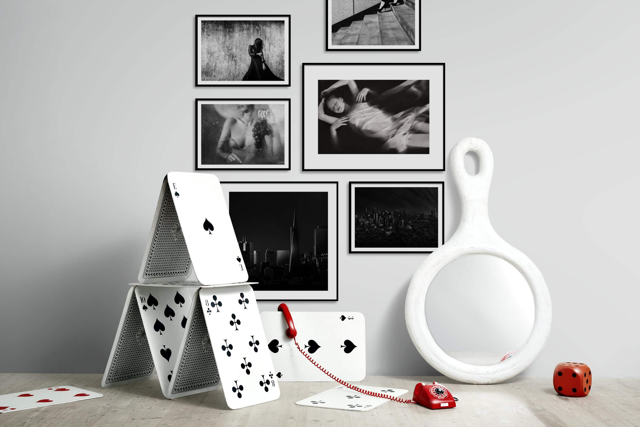 Gallery wall idea with six framed pictures arranged on a wall depicting Fashion & Beauty, Black & White, For the Moderate, Vintage, Artsy, For the Minimalist, City Life, and Americana