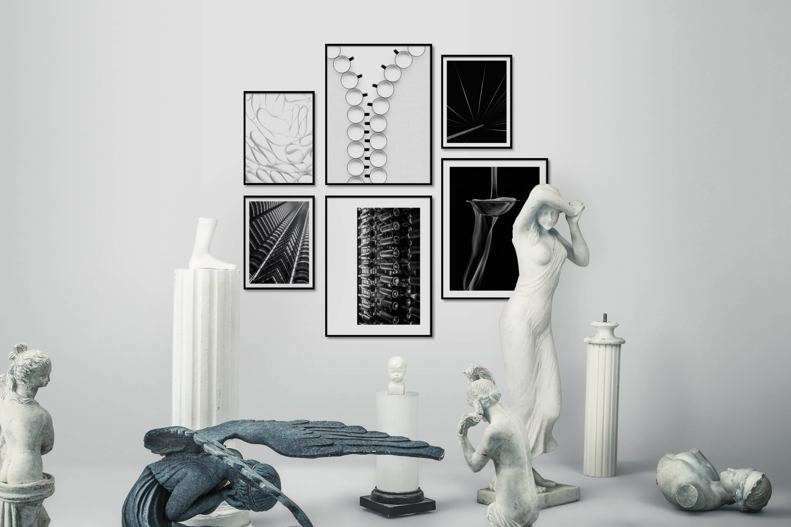 Gallery wall idea with six framed pictures arranged on a wall depicting Black & White, For the Moderate, Bright Tones, For the Minimalist, For the Maximalist, and City Life