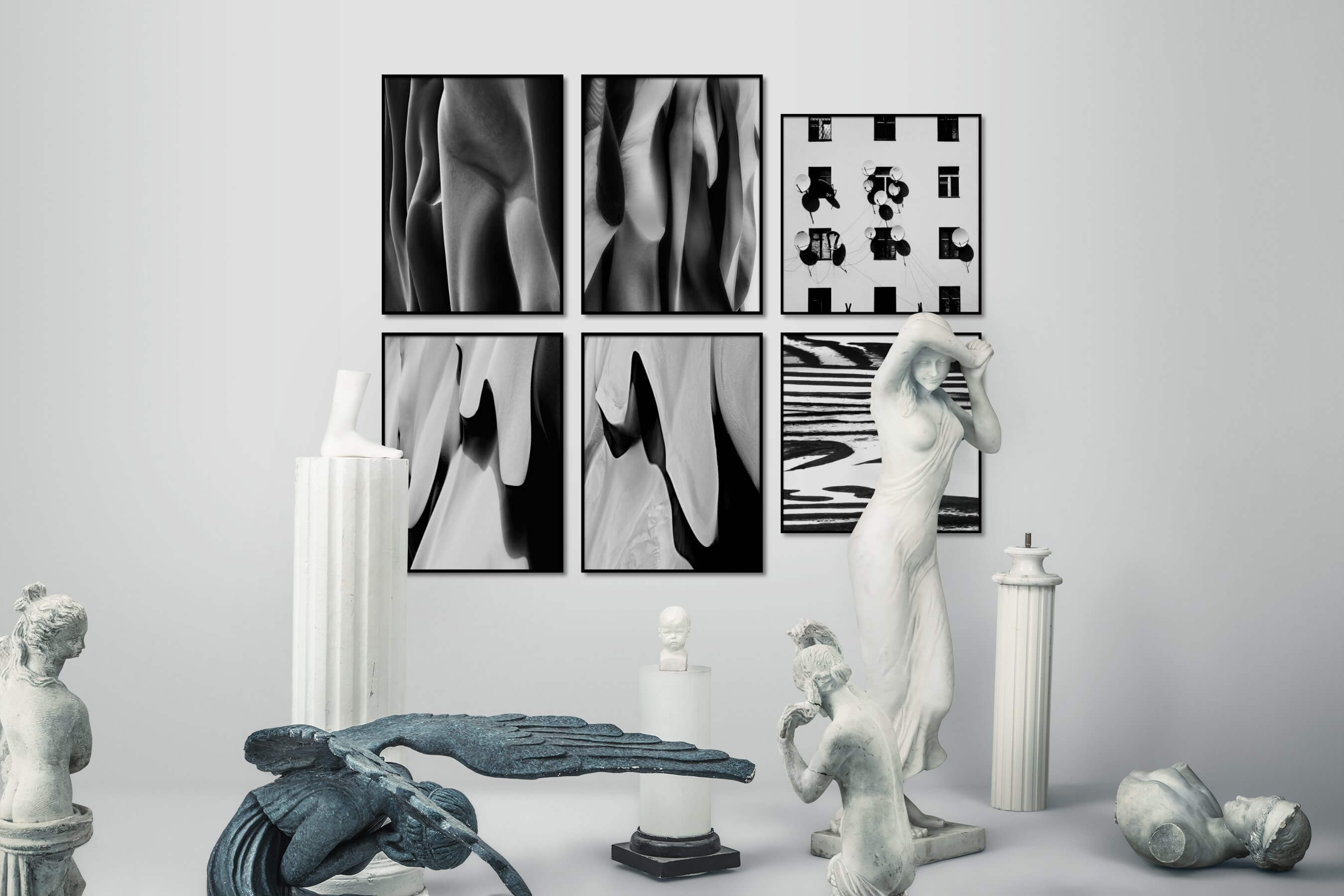 Gallery wall idea with six framed pictures arranged on a wall depicting Black & White, For the Moderate, Nature, For the Maximalist, and City Life