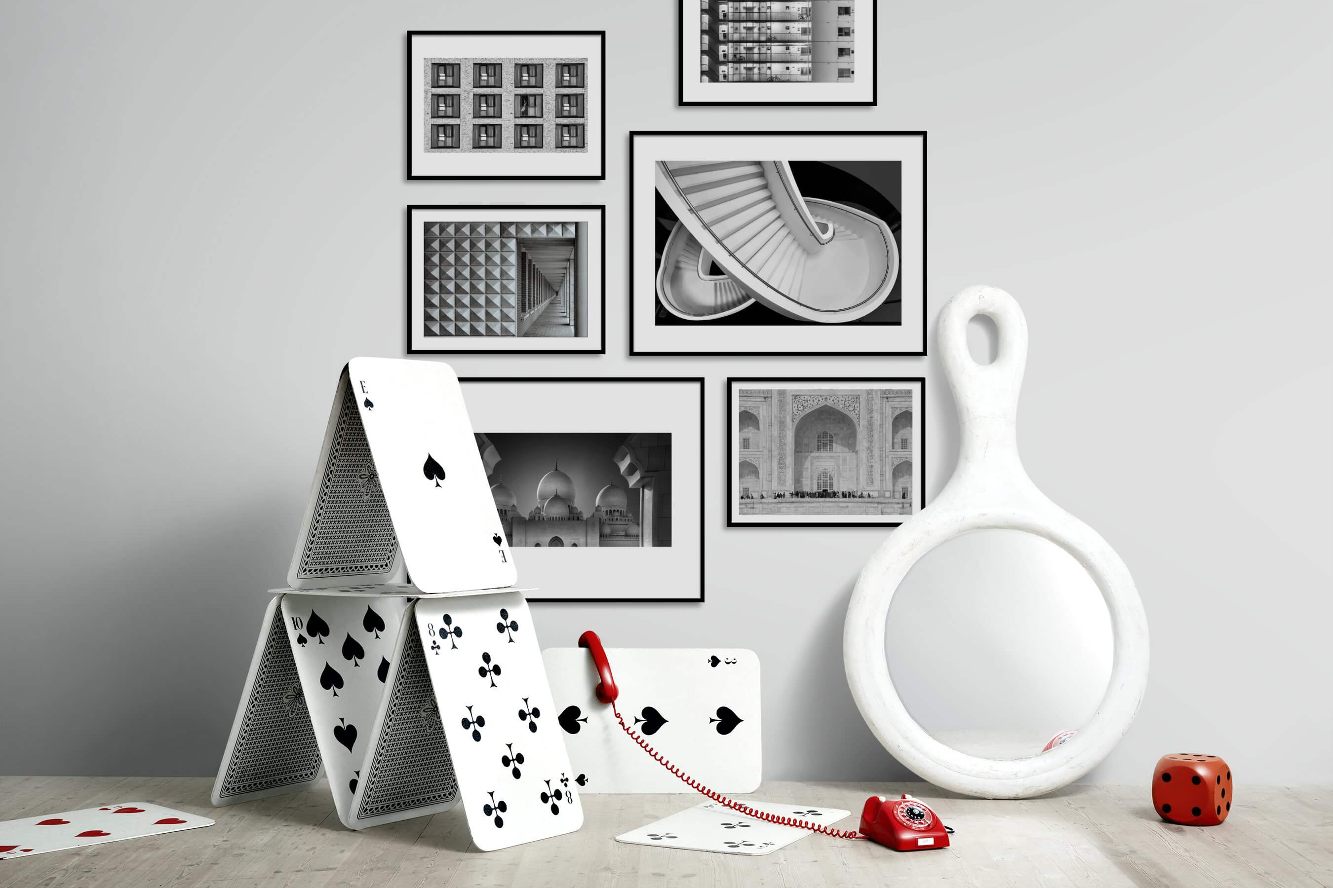 Gallery wall idea with six framed pictures arranged on a wall depicting Black & White, For the Moderate, City Life, and For the Maximalist