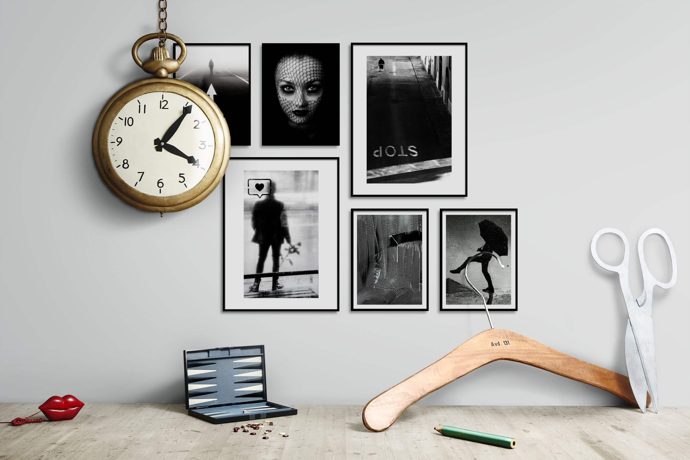 Gallery wall idea with six framed pictures arranged on a wall depicting Black & White, For the Moderate, Mindfulness, Fashion & Beauty, Dark Tones, For the Minimalist, Artsy, and City Life