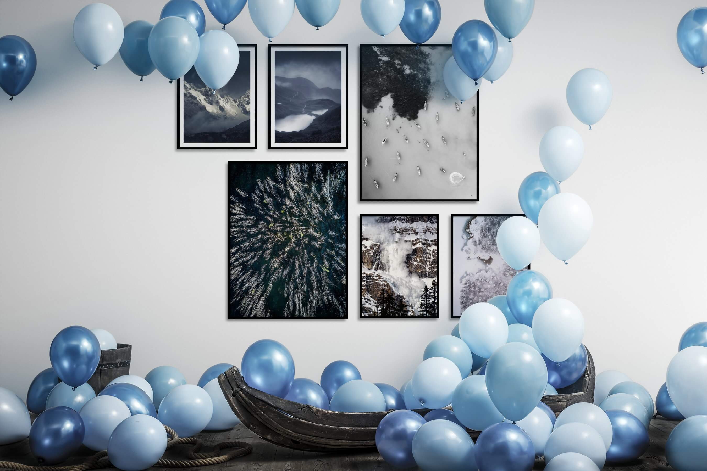 Gallery wall idea with six framed pictures arranged on a wall depicting Nature, For the Moderate, Black & White, and Beach & Water