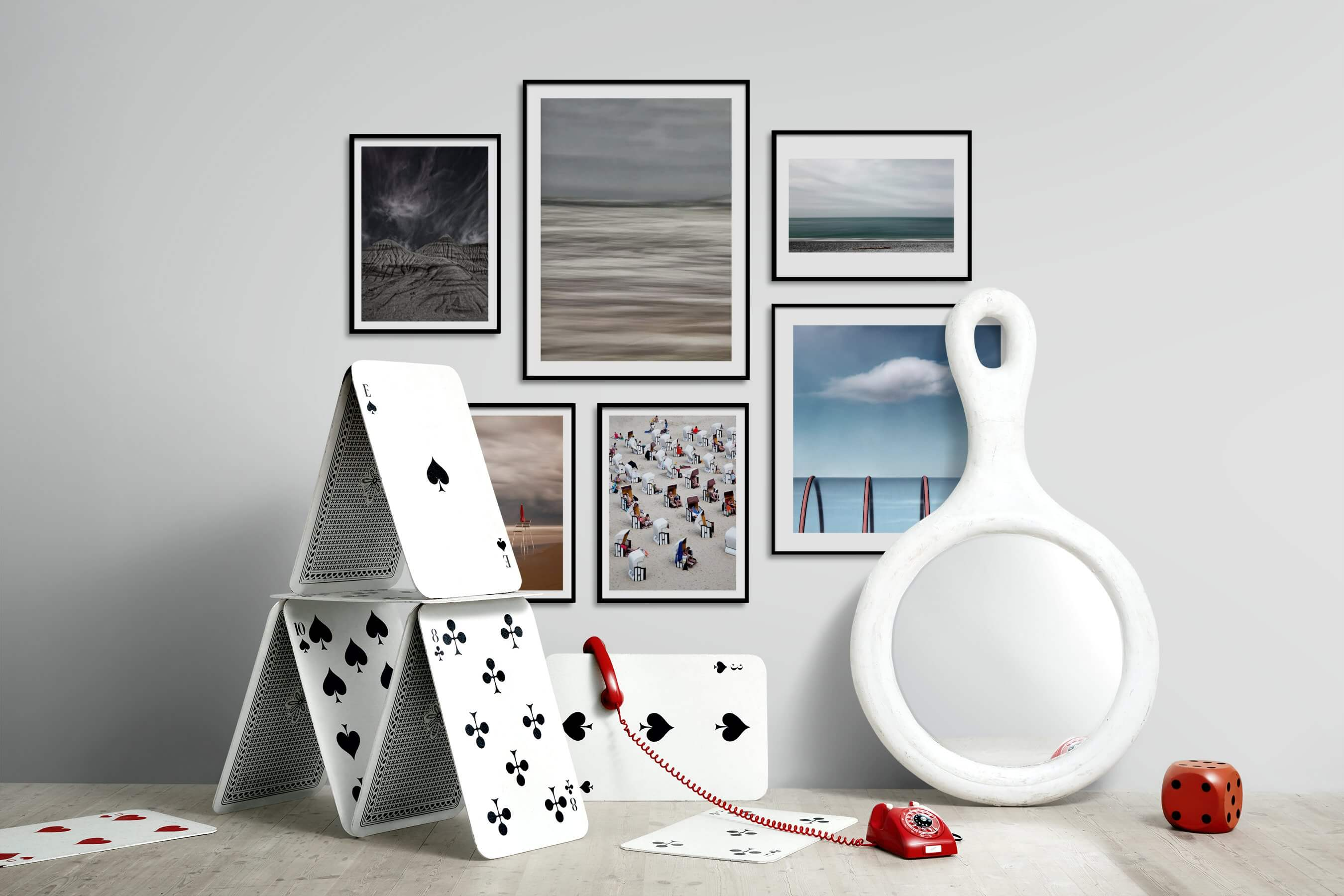 Gallery wall idea with six framed pictures arranged on a wall depicting Nature, For the Moderate, Beach & Water, For the Minimalist, and Mindfulness